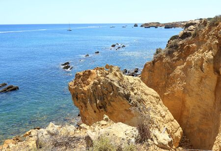 Jagged rocks overlooking the Atlantic Ocean near Albufeira in the Algarve region of Portugal