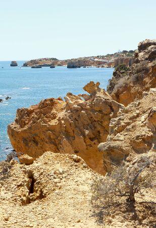 Rocky cliffs overlooking Praia De Arrifes