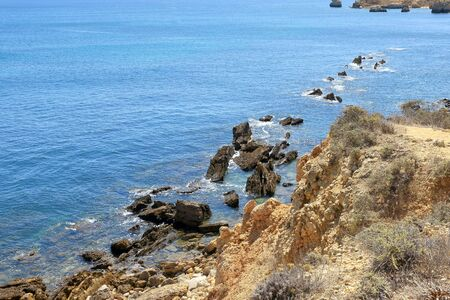 Rocky coastline near Albufeira in the Algarve Stock Photo