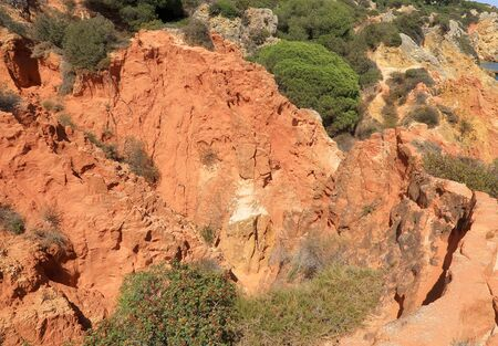 A view of the Red cliffs overlooking the ocean at the Caminho Da Baleeira nature reserve
