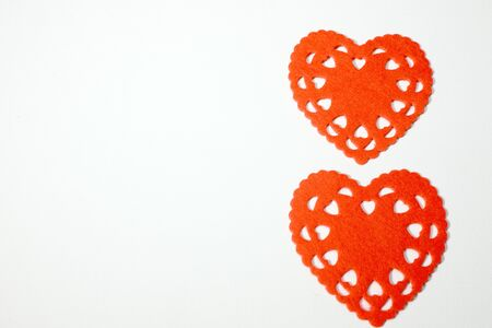 A pair of red heart shapes to illustrate the concept of love on Valentines day 写真素材