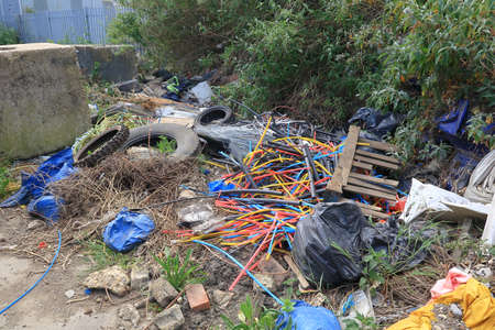 A pile of cable scraps and tyres dumped by the side