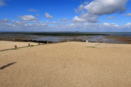 A view of the pebbled beach at Whitstable when the tide is out