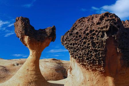 honeycombed: Rushroom rock and honeycombed rock  Stock Photo