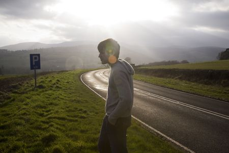 a man on side of a road Stock Photo