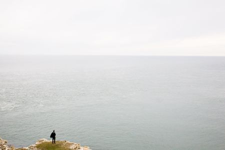 cliff edge: man by the cliff edge