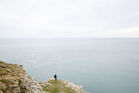 cliff edge: man by the cliff edge Stock Photo