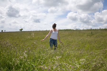 warmest: a woman in the middle of a field Stock Photo