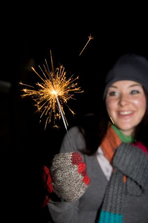 guy fawkes night:  a woman holding a sparkler at  firework