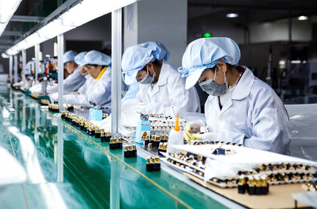 factory workers: Workers in the factory