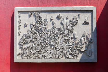 Stone carving of flowers blossom art