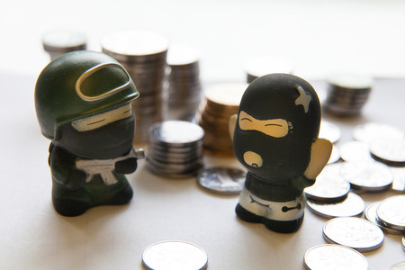 police & robber with coin, protection of financial concept photo