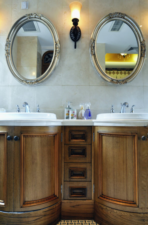 cabinets: cabinets and shower mirror at toilet  Editorial