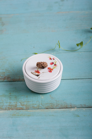 eacute: Jar on blue wooden background Stock Photo
