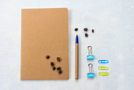 office appliances: Coffee beans and office supplies Stock Photo