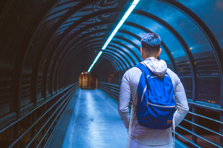 Man standing in tunnel carrying backpack Stockfoto