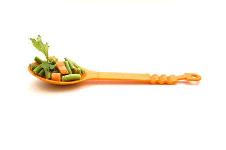 Soup vegetables on Spoon