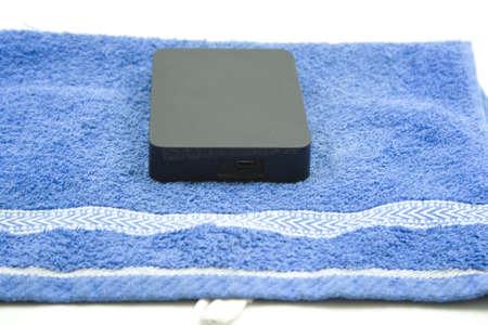 External Black Harddrive on Blue Towel  Stock Photo - 17568656