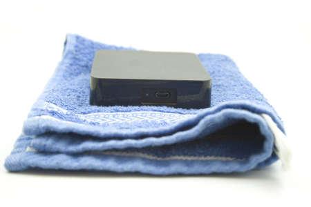harddrive: External Black Harddrive on Blue Towel  Stock Photo