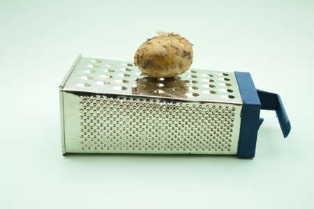 grater: Brown Potato  on Grater  Stock Photo