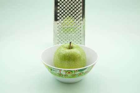 grater: Apple in Bowl with Grater