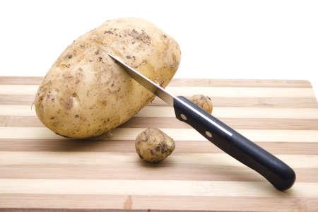 potatos: Fresh Brown Potatos  with knife