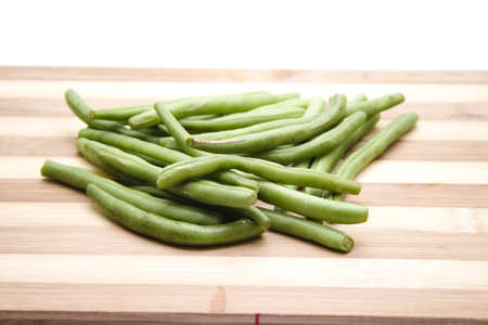 Green String beans on Wooden Plate