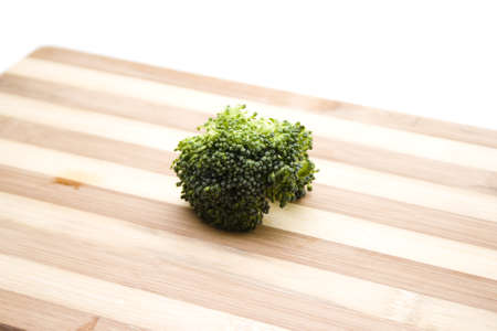 Fresh Green Broccoli on Wooden Plate