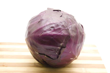 Fresh Red Cabbage on wooden plate