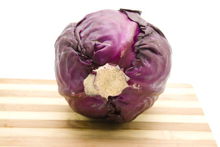 Red Cabbage for cooking on wooden plate  Stock Photo