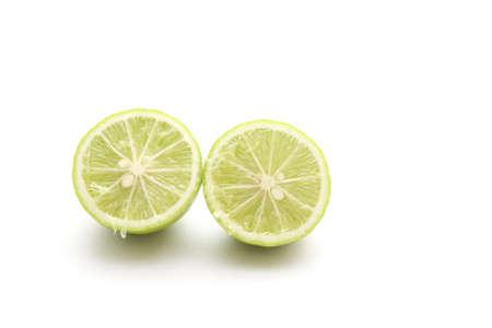 Green Lemon on white background  photo