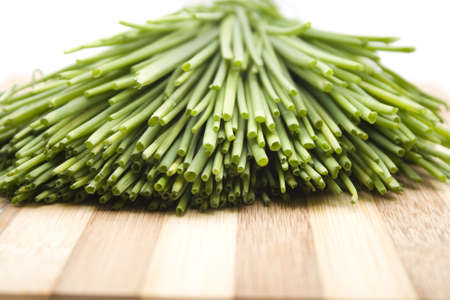 Fresh Green Chives on Wooden Plate  Stock Photo