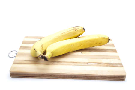 Yellow Banana on wooden Plate  Stock Photo