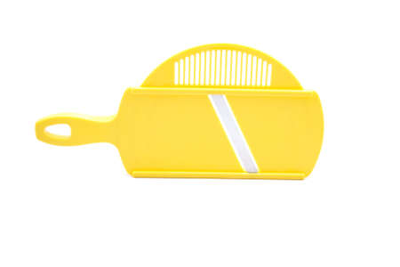 Yellow Grater on White Background