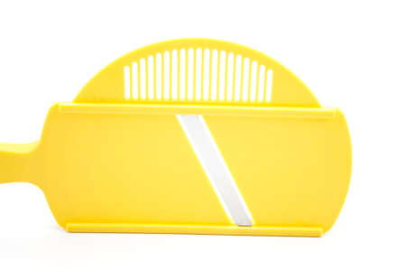 grater: Yellow Grater on White Background