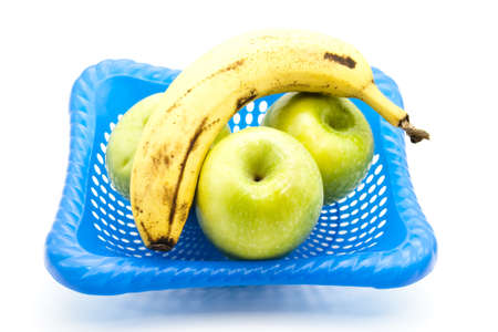 Green Apples with Yellow Banana in Basket