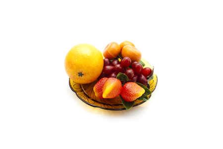 glas: Plastic Fruits on brown Glas Plate