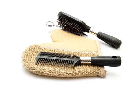 Hairbrush with Scissors on Massage Glove  Stock Photo