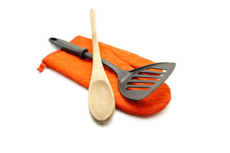Red Potholder with Spatula and Wooden Cooking Spoon Stock Photo