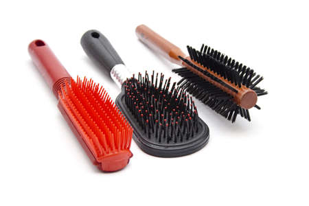 Different hairbrush on white background