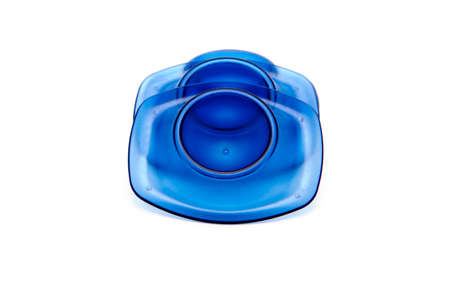 Blue Plastic Egg Cups on white background Stock Photo