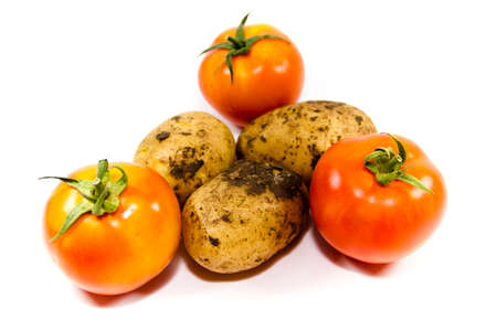 Fresh Brown Potatoes and Red Tomatoes Stock Photo