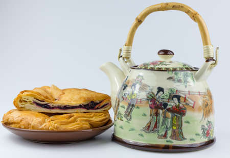 blueberry muffin: teapot and muffin on a plate Stock Photo