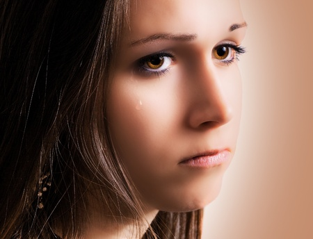 sincere girl: Close up of tear rolling down cheek Stock Photo