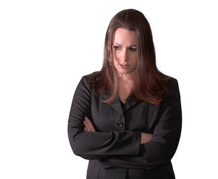 Sad woman in business suit on white background. photo