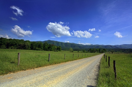 Summer day with country road in the mountains photo