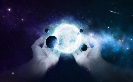 gods: Two hands holding the sun and planets in the universe