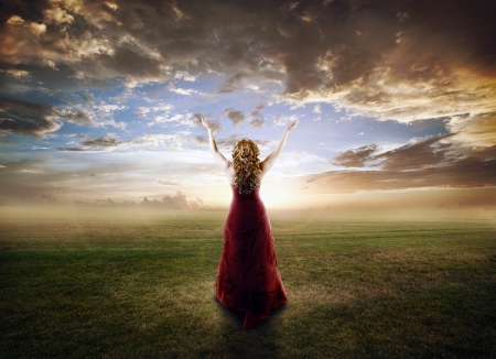 Woman lifting up her hands at sunset Stock Photo - 15385243