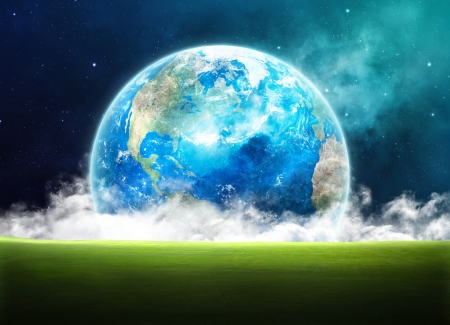 surreal landscape: Earth rising in space over a green grassy field