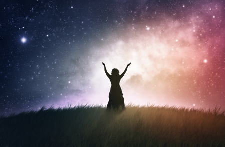 A woman lifting her hands with a space background